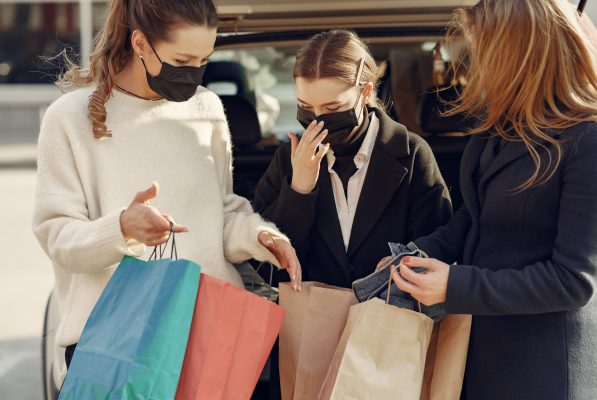 Mom and daughters shopping with masks