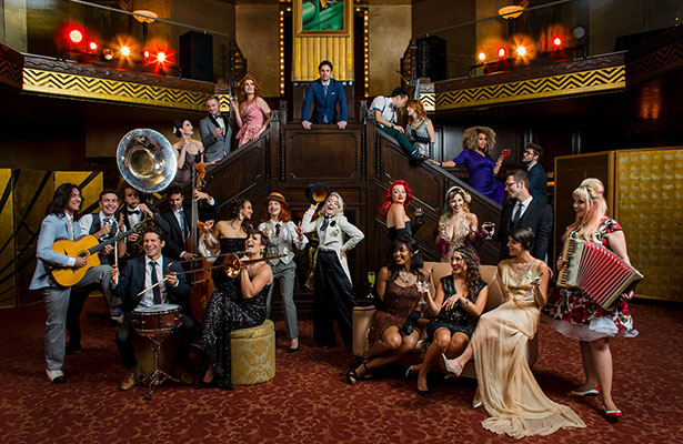 Postmodern Jukebox ensemble in period costumes with musical instruments